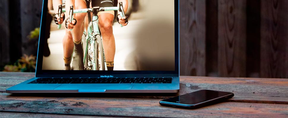Computer with an image of a cyclist pedaling.
