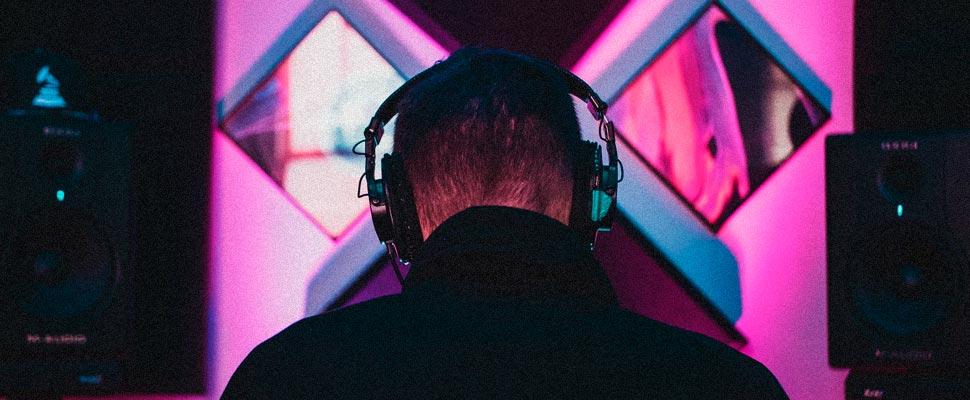 Man in a recording studio wearing headphones.