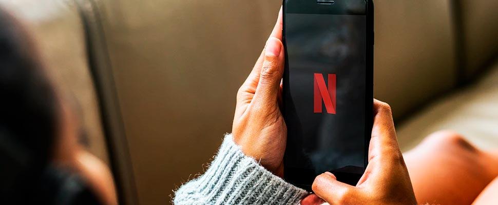 Woman watching Netflix on a phone