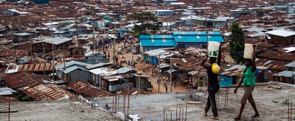 Urban Slum with two people working.