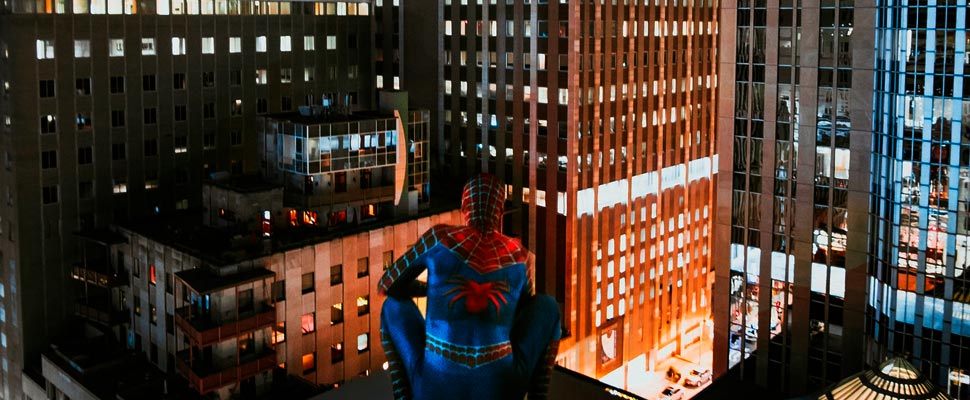 Spider Man on top of a building.