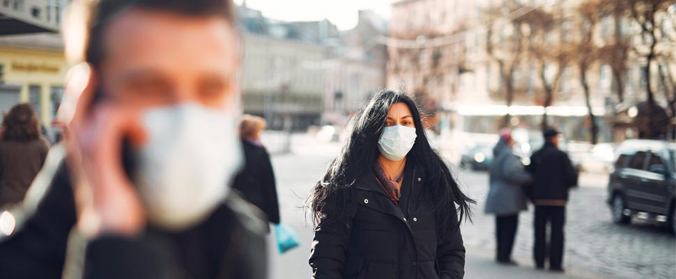 Woman wearing a mask in the street