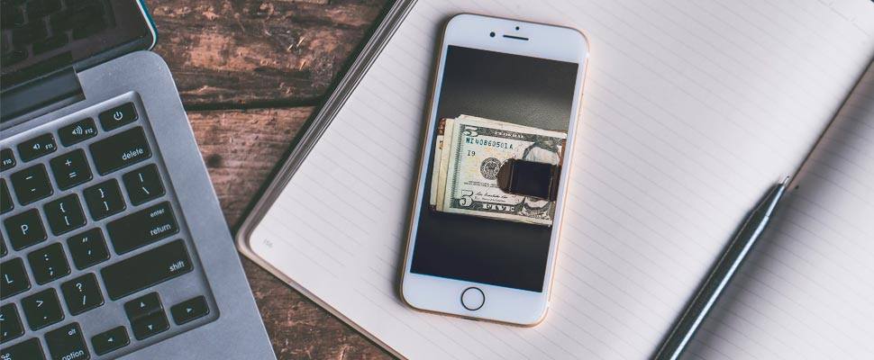 Cell phone showing a wallet with money.