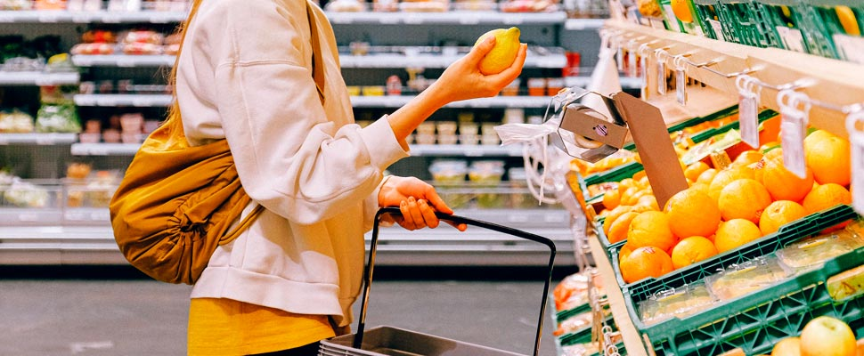 Woman choosing lemons in a supermarket
