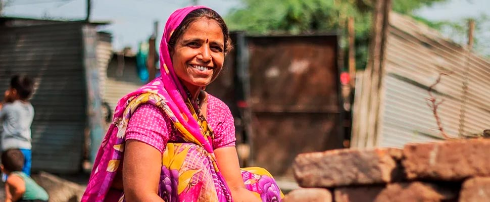 Woman smiling on a street in India.