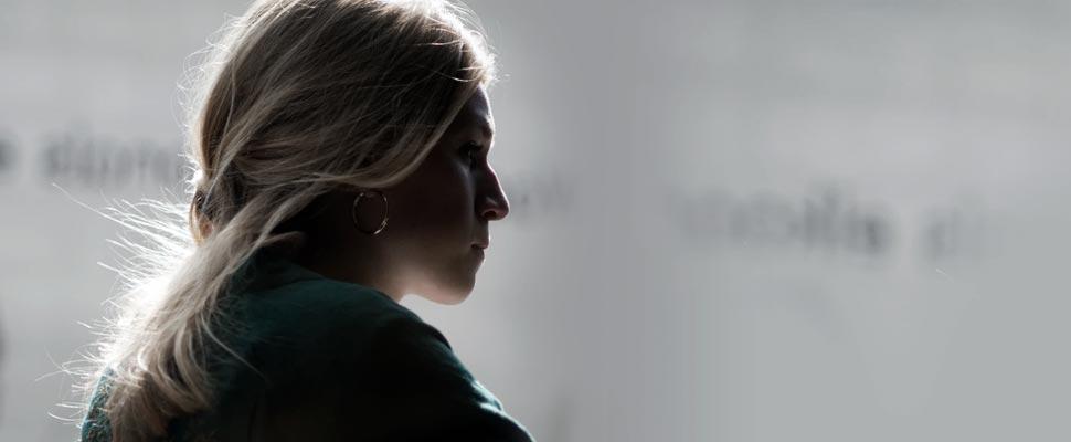 Woman sitting in profile