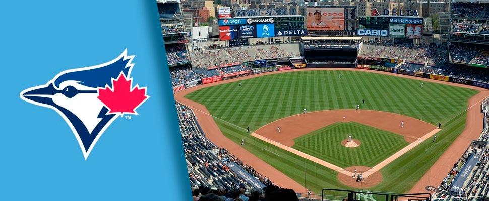Emblema de los Toronto Blue Jays y vista de un estadio de la MLB