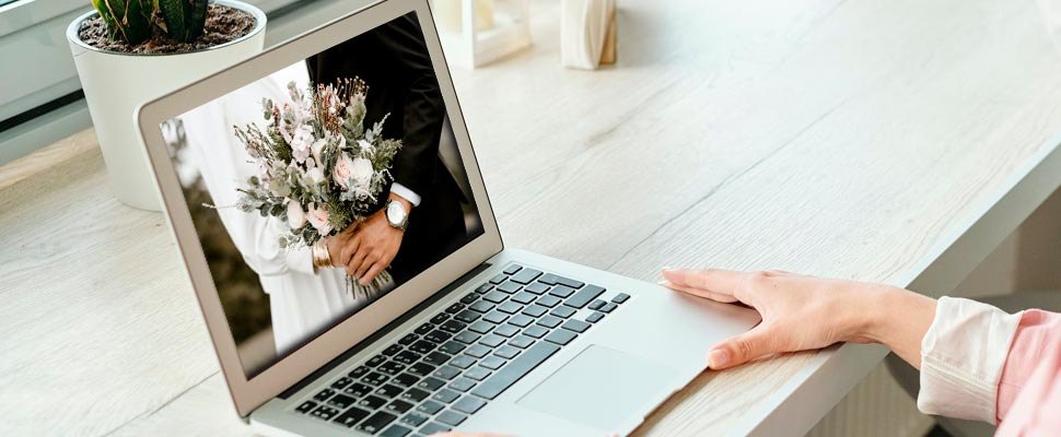 Photograph of a wedding on a laptop