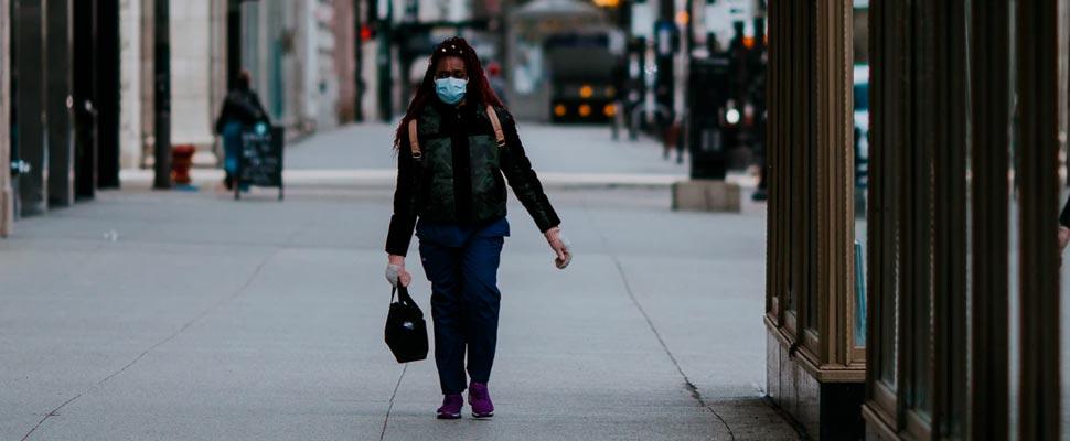Woman wearing a face mask walking in the street