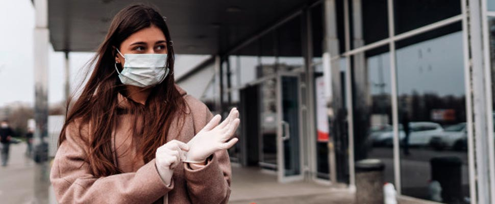 Woman wearing a mask and latex gloves