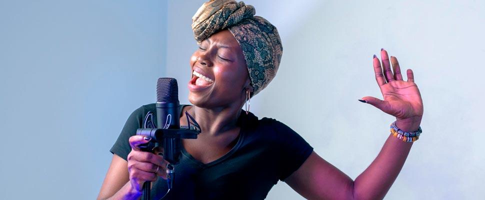 Woman singing in music studio