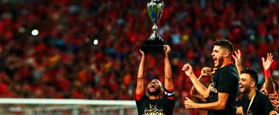 Al Ahly Cairo team players lifting the champions cup