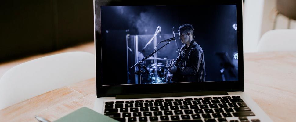 Computer with the image of a man playing guitar