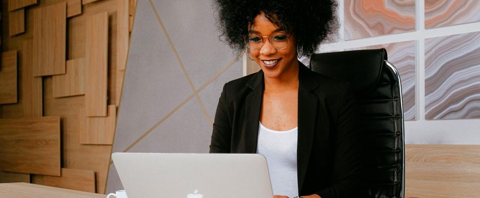 Business woman working with her laptop.