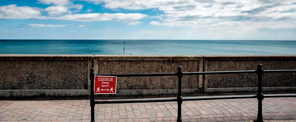 Boardwalk with COVID-19 sign