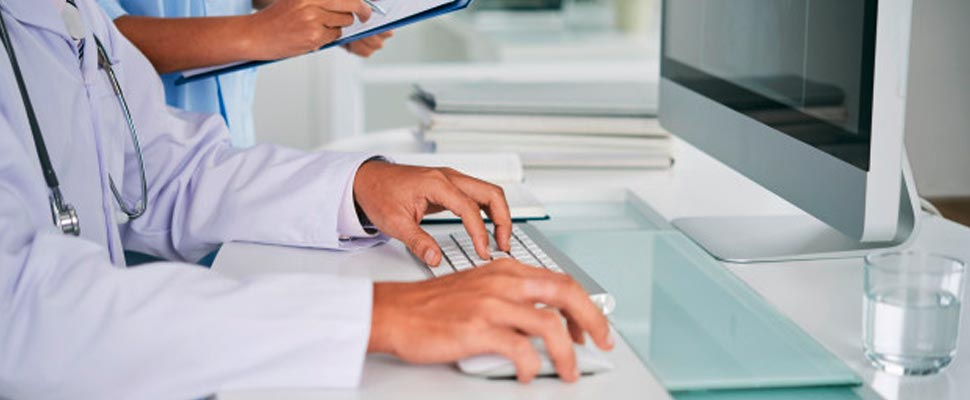 Doctor working in a computer