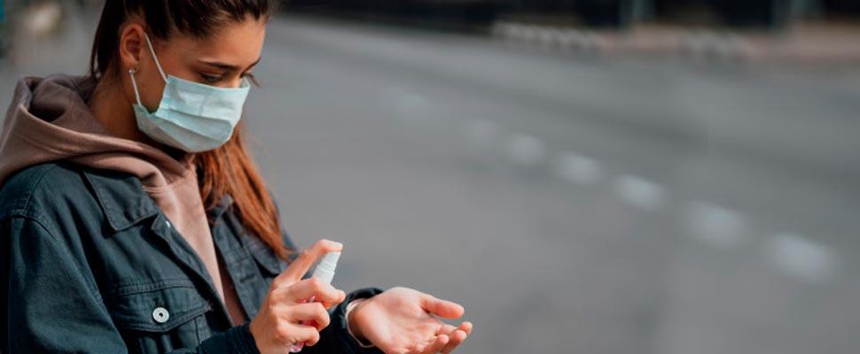 Woman applying antibacterial hand gel