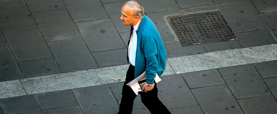 Older man walking down a street