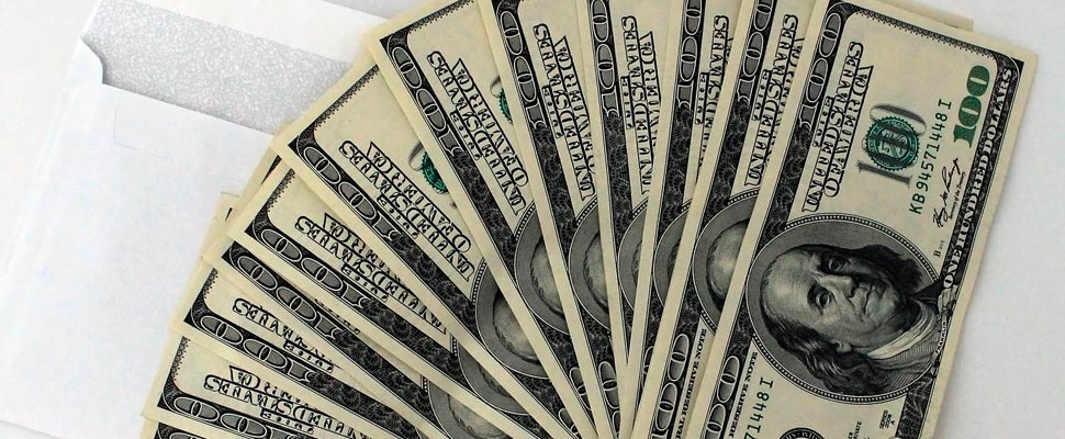 How will the increased printing of dollars affect Latin America?