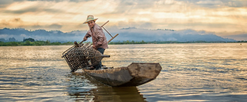 Fisherman in the middle of the sea