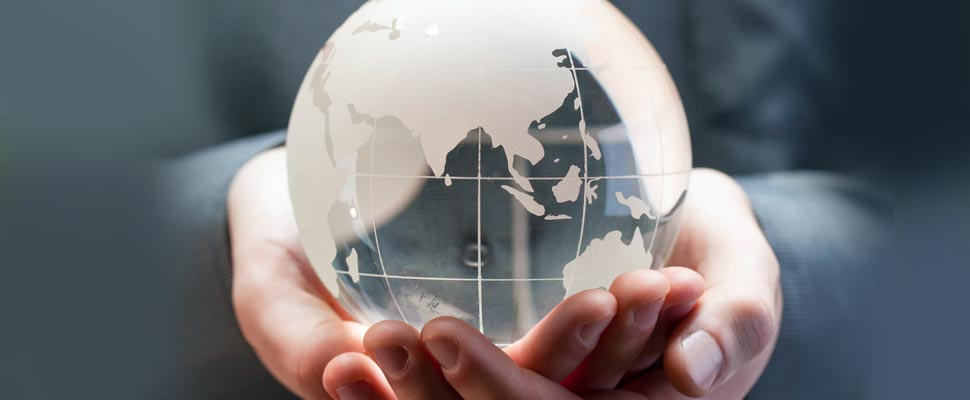 Person holding a figure of the planet in glass