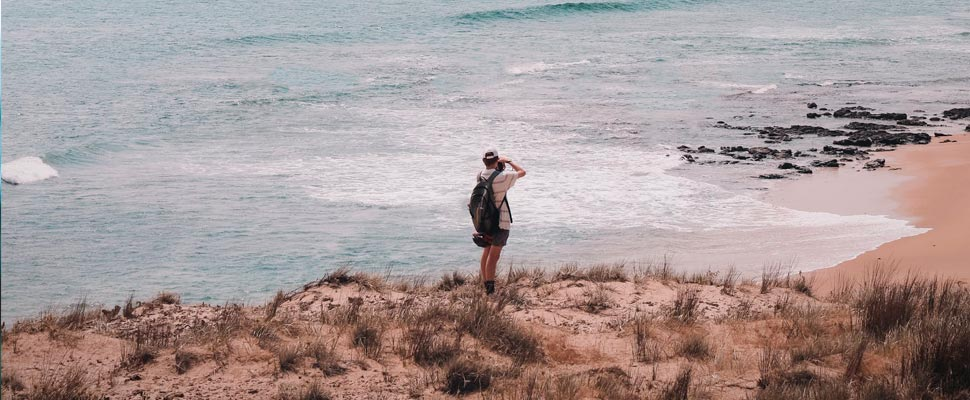 Person taking photos on the seashore