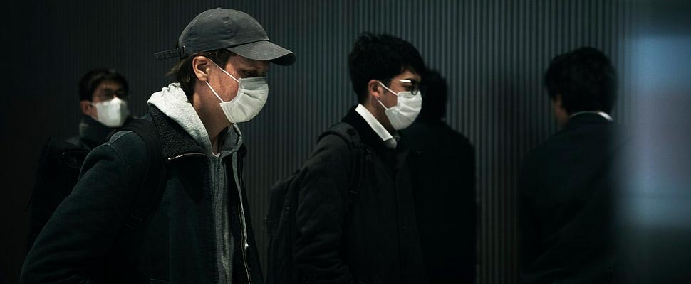 Commuters wearing disposable masks hoping to prevent the spread of corona virus