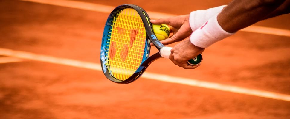 Close-up of a person holding a tennis racket