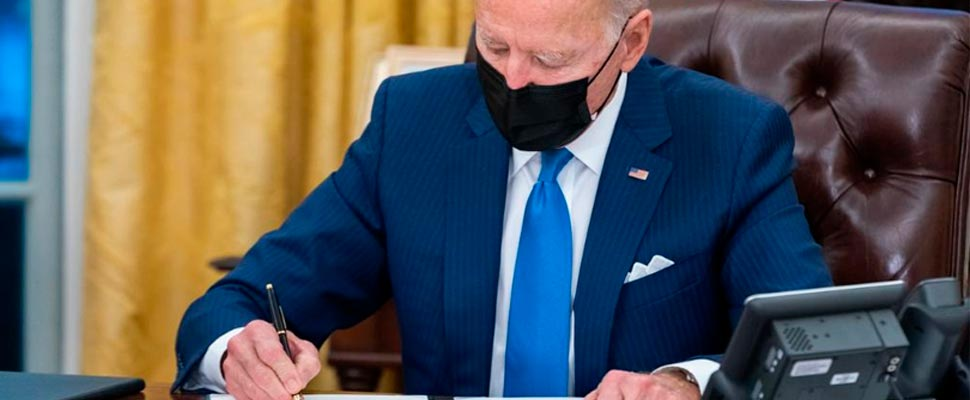 Joe Biden signing a document