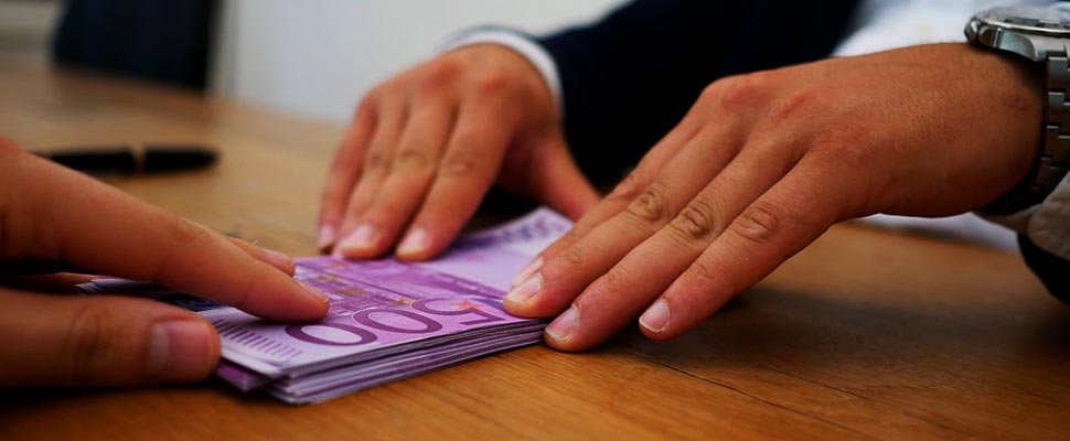 Hands of two people with money