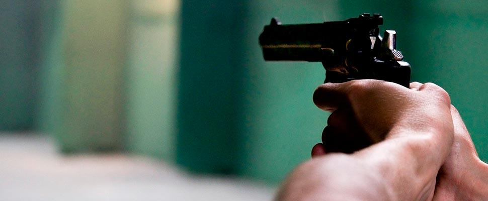Man wielding a gun