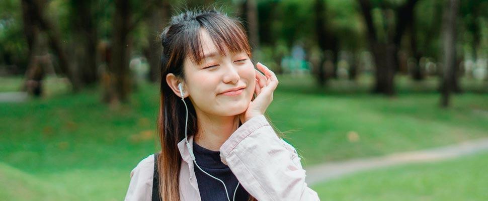 Woman listening to music wearing headphones