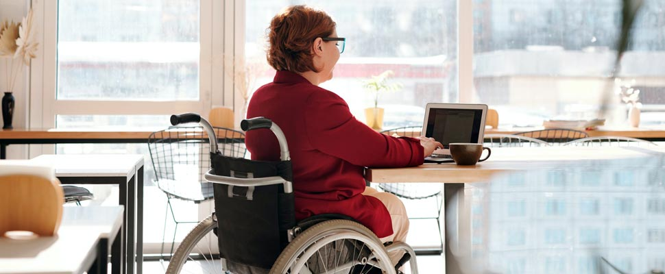 Woman in a wheelchair at an office