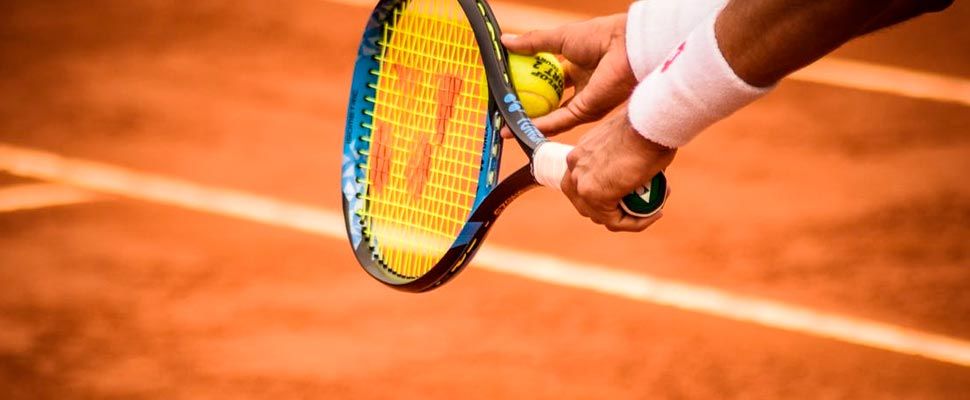 Close-up tennis player with racket and ball