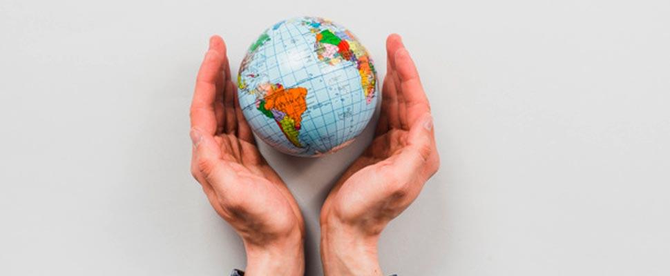 Hands holding a globe figure
