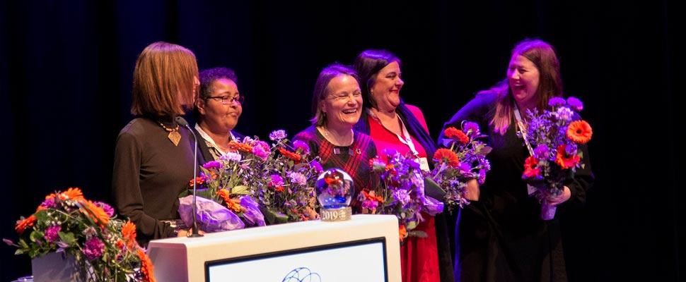 Women receiving a prize
