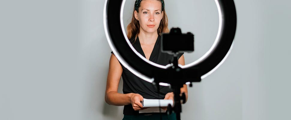 Woman making a recording holding a notepad