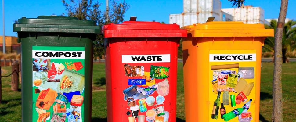Three recycling bins