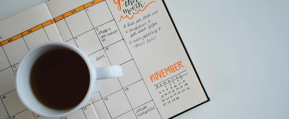 Cup of coffee on calendar