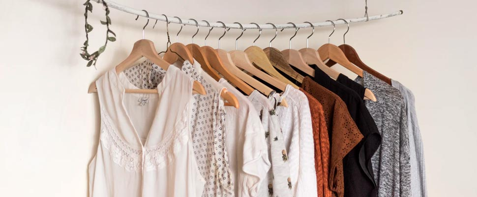Four assorted apparel hanged on clothes