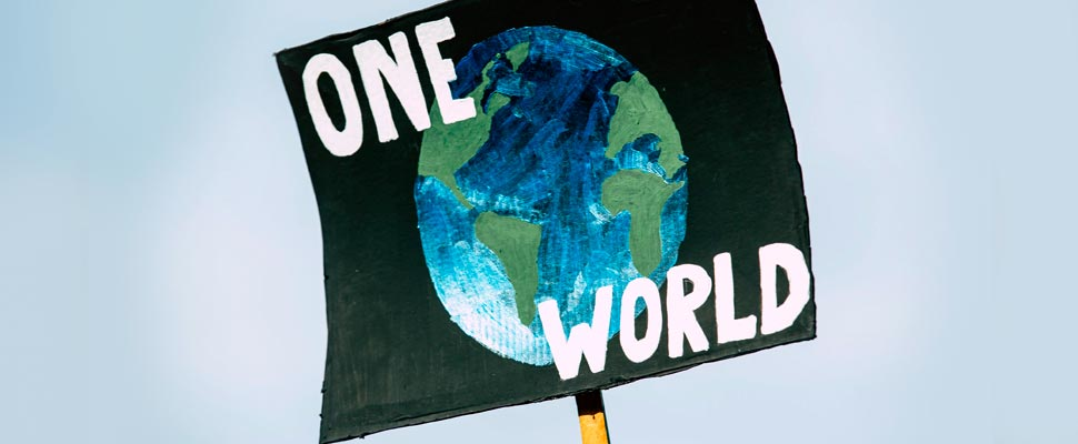 Poster with the phrase 'One World' and a drawing of the planet Earth