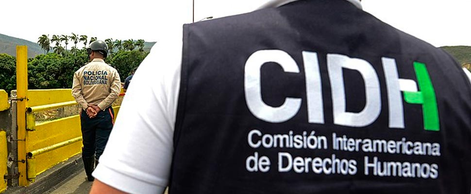 Man wearing a garment with the initials IACHR
