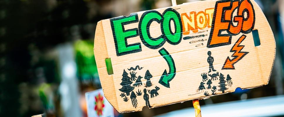 Sign stating 'Eco not Ego'