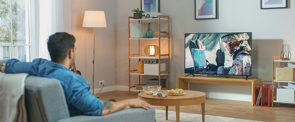 Man sitting on a sofa watching TV