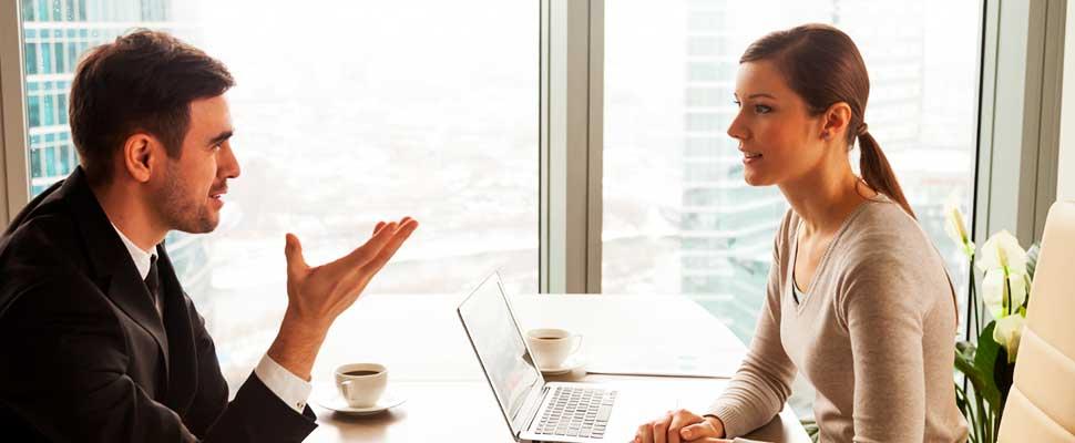 Woman talking to a man