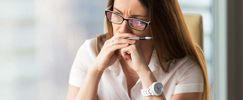 Woman thinking while she's in an office