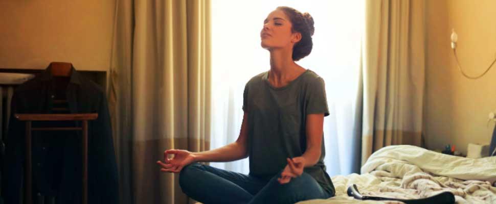 Woan meditating at bed