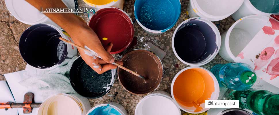 Paint in plastic cups with brushes
