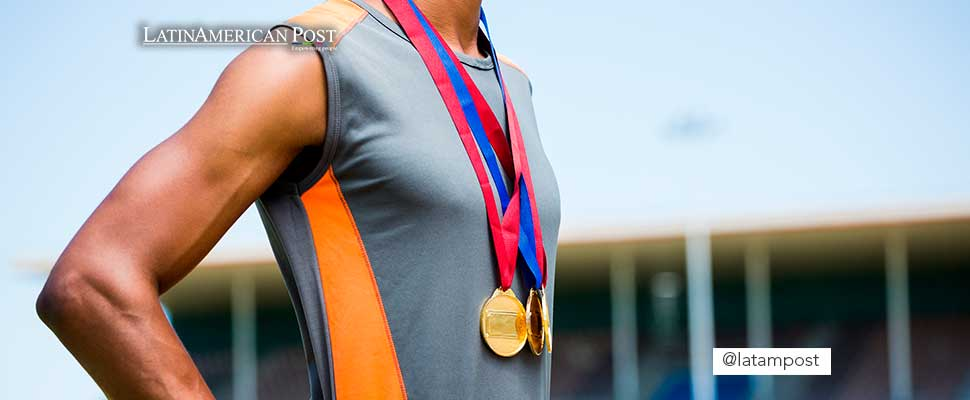 Athlete with medals hanging from his neck