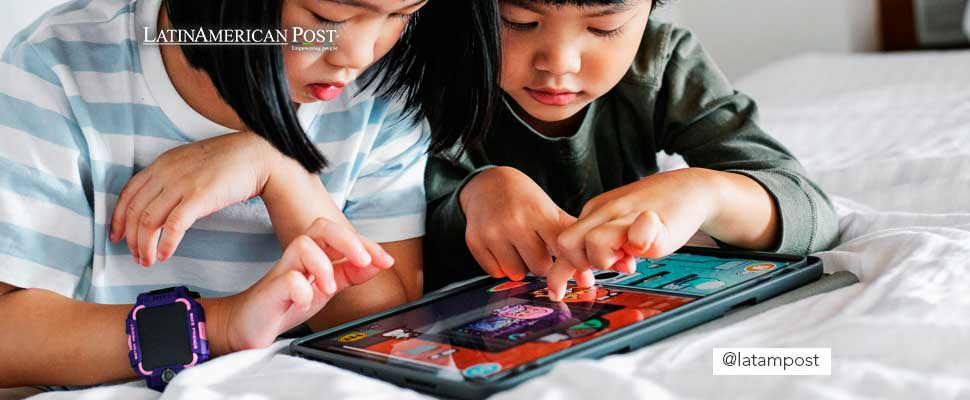 Children playing with a tablet
